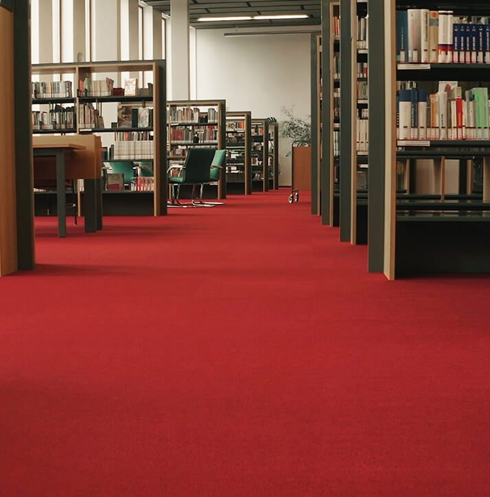 IVC Carpet Tiles define departments by colour at the Moravian Library in Brno