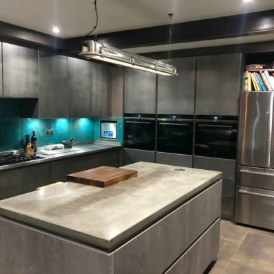 Concrete Kitchen Island with liquid metal lettering